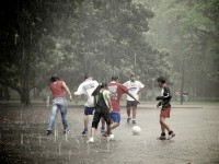 Teenagers playing soccer in the rain, ©marlon.net/Flickr